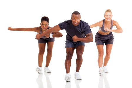 group of fit young adult exercising, isolated on white background photo