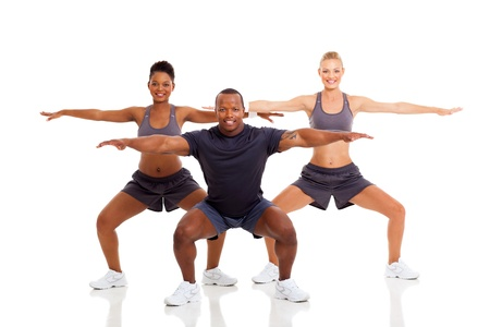 smiling young fit people exercising and stretching on white background photo