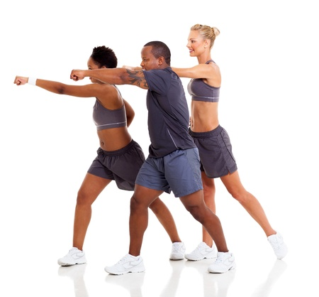 group of fit people exercising karate on white background photo