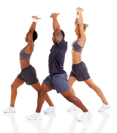 three people stretching before exercising, isolated on white photo
