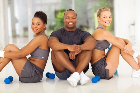 group of healthy people sitting after working out photo