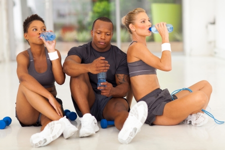 young fit people after exercise drinking water photo