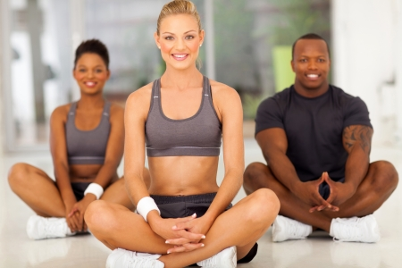 cheerful healthy woman relaxing after exercise with two friends photo