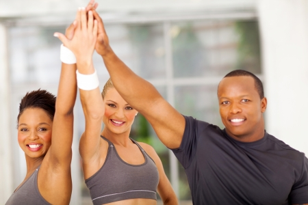 high up: group of healthy people celebrating after exercise Stock Photo