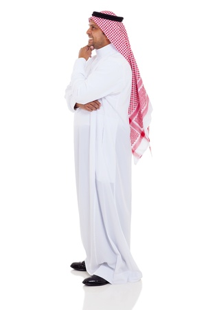 side view of smiling islamic man on white background photo