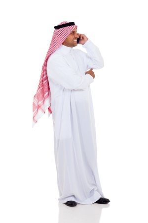 arab man: cheerful muslim man talking on cell phone, isolated on white Stock Photo