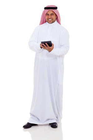 arab adult: full length portrait of middle eastern man using tablet computer on white background Stock Photo