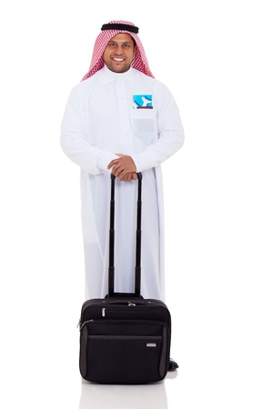happy male arabian business traveller with luggage and air ticket photo