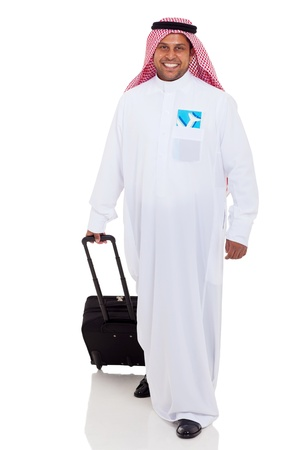 cheerful arabic businessman travelling by air photo