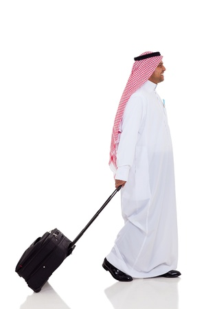 side view of middle eastern business traveller isolated on white photo