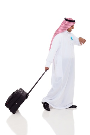 business traveler: arabic business traveler checking time Stock Photo