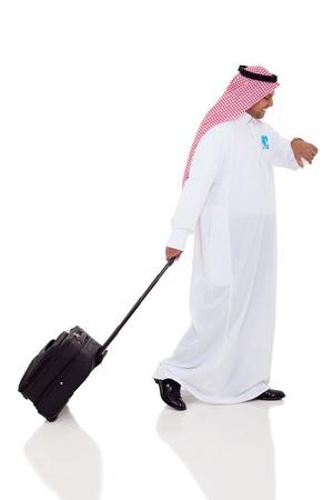 arabic man: arabic business traveler checking time Stock Photo