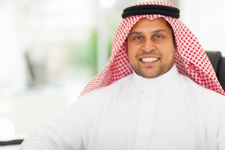 close up portrait of happy middle eastern businessman in office Stock Photo - 19637504
