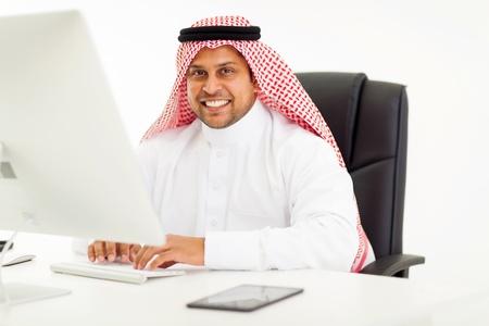modern arabic businessman using computer in office photo