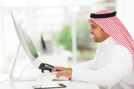 modern arab muslim businessman working on a computer Stock Photo - 19637482