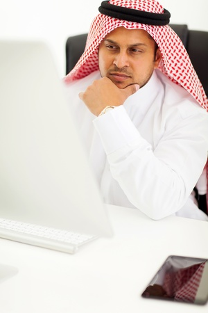 thoughtful arabian businessman looking at computer screen Stock Photo - 19637451