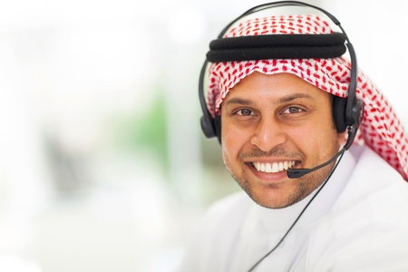 agal: arabic business man with headphone in office