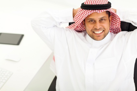 above view of smiling middle eastern businessman relaxing in office Stock Photo - 19637487