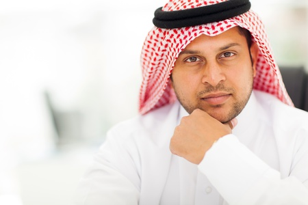 agal: handsome arabic businessman close up portrait in modern office