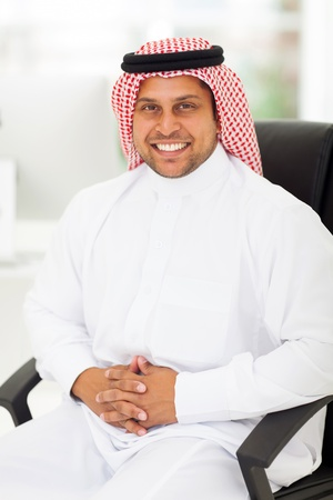 handsome arabic businessman sitting in the office photo