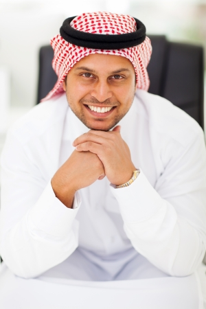 portrait of happy arabian businessman in office Stock Photo - 19637494