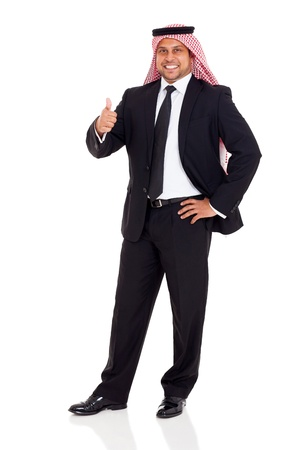 happy arab man in black suit giving thumb up on white background photo