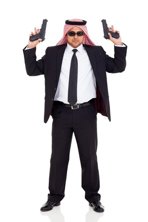 middle eastern hitman in black suit holding two handguns on white background photo