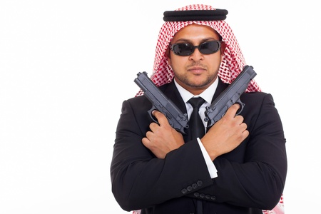 arabian mafia man holding pistols over white background photo
