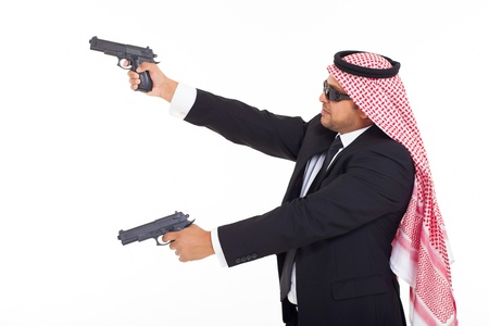 side view of arabic bodyguard holding guns on white background photo
