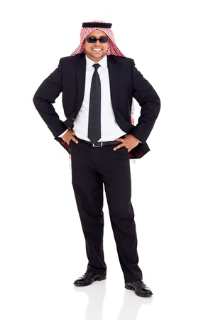 cheerful arab man in black suit posing on white background photo