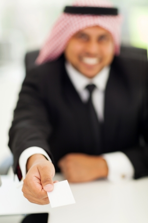 arabic businessman giving his business card  photo