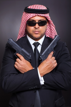 arabic secret service agent holding two handguns photo