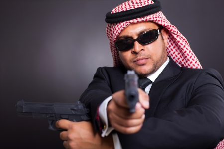 arabian spy with two handguns photo