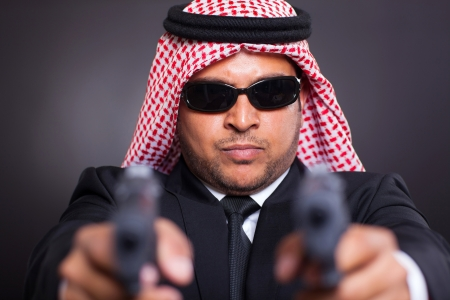 dangerous arabian mafia man with handguns photo