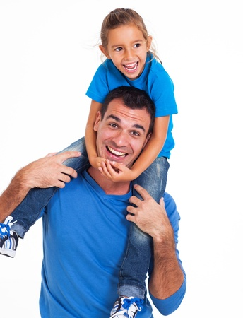shoulder ride: playful father carrying his little daughter on his shoulders isolated on white background