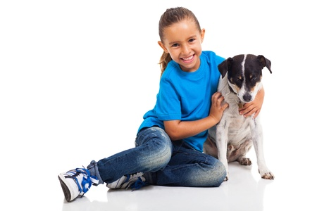 blue jeans kids: adorable cute little girl and her pet dog isolated on white Stock Photo