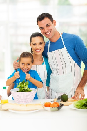 child food: beautiful young family cooking in kitchen at home Stock Photo