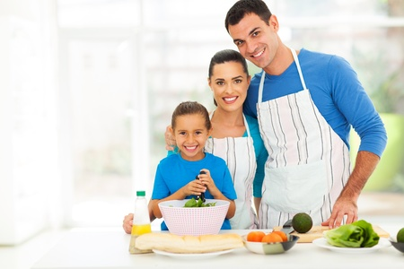 adorable young family cooking in kitchen at home photo