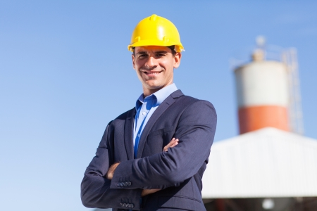 mine site: male industrial engineer in mining site with arms crossed Stock Photo