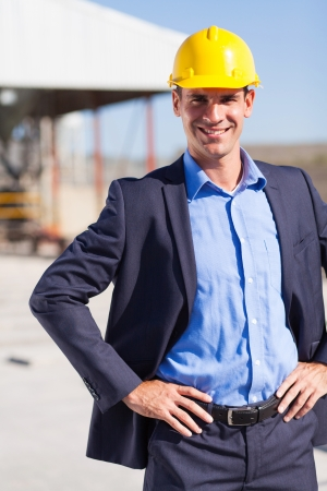 workplace safety: happy construction manager portrait outdoors Stock Photo