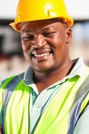 cheerful african american male construction worker outdoors photo