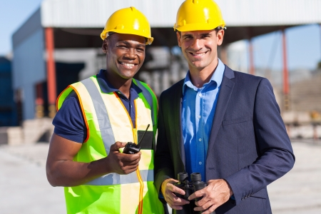 cheerful african construction worker and manager portrait outdoors photo