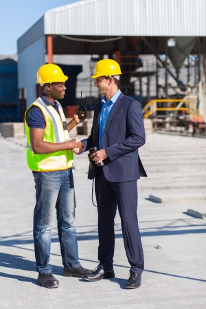 construction manager and worker handshake on site photo