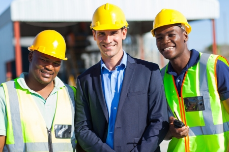 cheerful construction businessman and workers outdoors photo