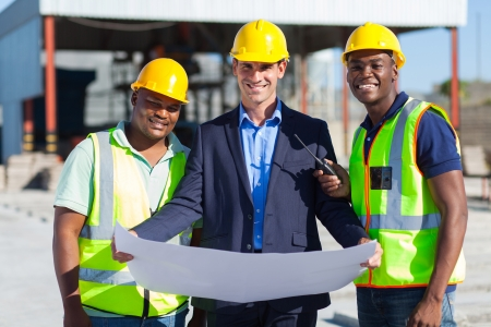 cheerful man architect team on construction site photo