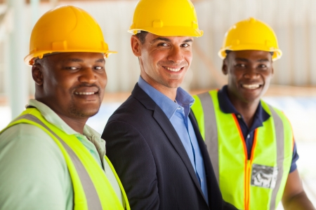 construction workers: group of cheerful professional construction manager and workers