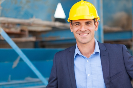 handsome modern industrial manager portrait in front of machinery photo