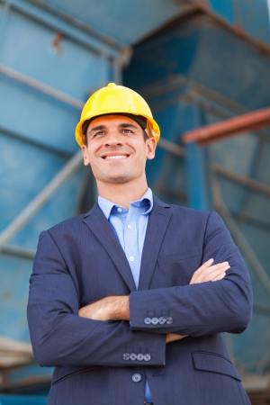 businessman with arms folded in construction site photo