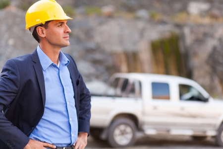 site manager: handsome determined mine manager visit mining site Stock Photo