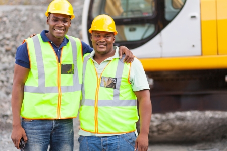 mine site: african industrial co-workers portrait in front of machine Stock Photo